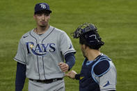 Tampa Bay Rays starting pitcher Blake Snell celebrates the end of the fifth inning with catcher Mike Zunino against the Los Angeles Dodgers in Game 6 of the baseball World Series Tuesday, Oct. 27, 2020, in Arlington, Texas. (AP Photo/Tony Gutierrez)