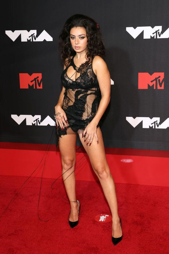 Charli XCX brought some Halloween vibes in this daring lace number at last night's VMAs. (Getty Images)
