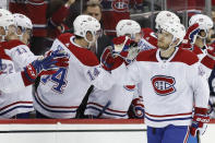 Montreal Canadiens right wing Joel Armia (40) is congratulated for his goal during the second period of the team's NHL hockey game against the New Jersey Devils, Tuesday, Feb. 4, 2020, in Newark, N.J. (AP Photo/Kathy Willens)