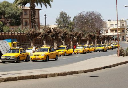 Yellow taxis queue for passengers along a street in Asmara, Eritrea in this photo taken on February 21, 2016. Picture taken February 21, 2016. REUTERS/Thomas Mukoya/Files