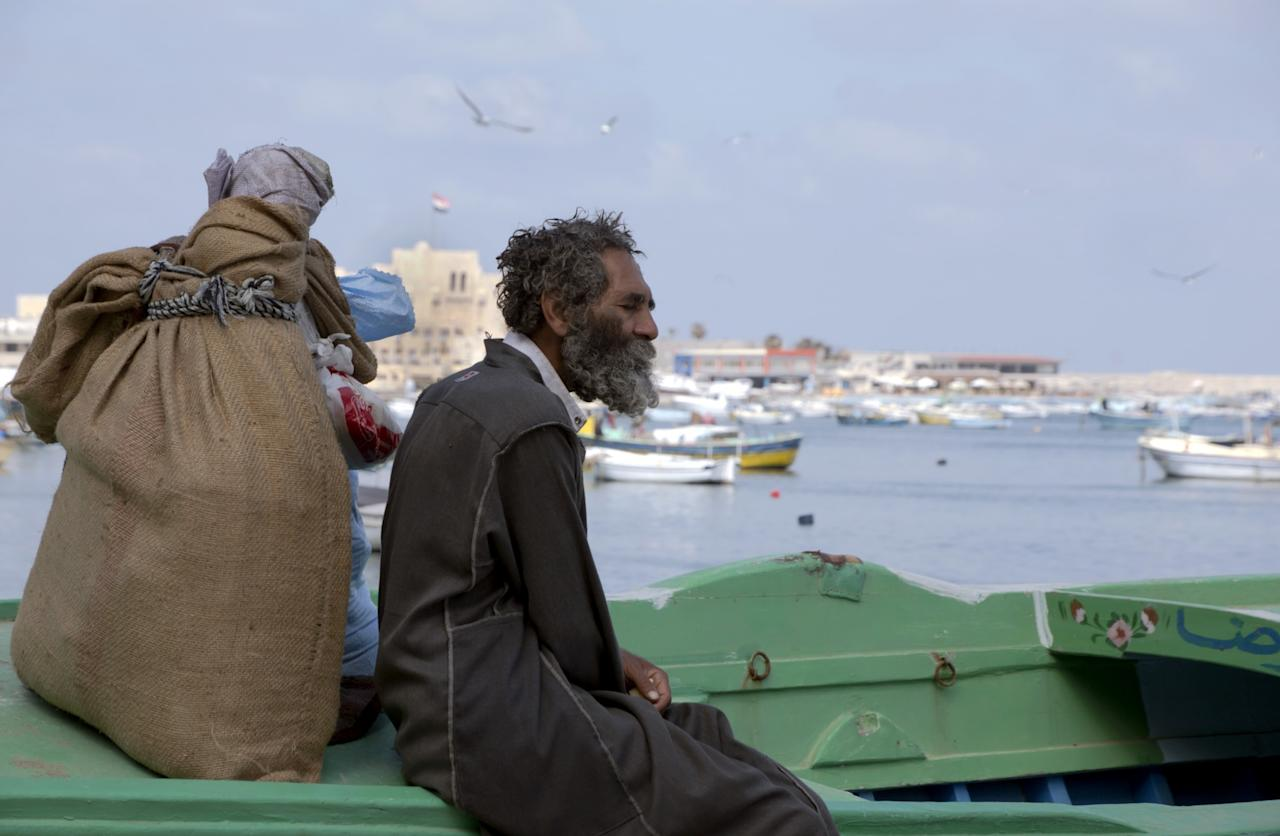 <p>In this Sunday, March 26, 2017 photo, a homeless man sits on a boat on the Mediterranean Sea coast, in Alexandria, Egypt. (AP Photo/Amr Nabil) </p>