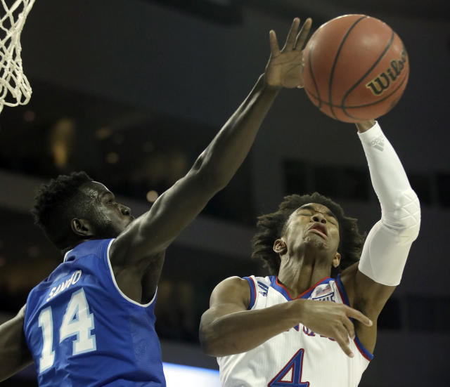Seton Hall forward Ismael Sanogo (14) blocks a shot by Kansas guard Devonte' Graham (4) during the first half of an NCAA men's college basketball tournament second-round game, Saturday, March 17, 2018, in Wichita, Kan. (AP Photo/Orlin Wagner)