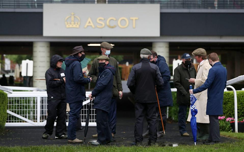 Ground staff gather to conduct a course inspection at Royal Ascot - PA