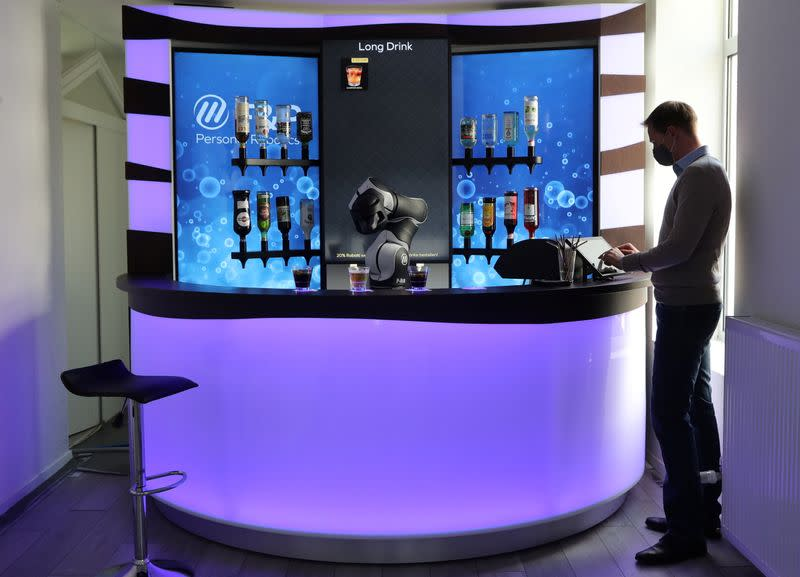 F&P Robotics CSO Colombo taps a display to order a drink at the Barney Cocktail Bar in Zurich