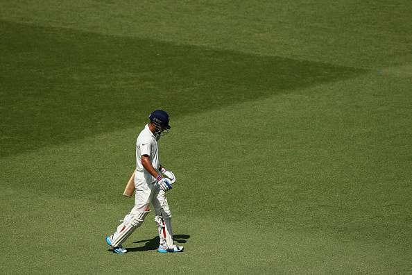 SYDNEY, AUSTRALIA - JANUARY 09: Virat Kohli of India walks off the field after being dismissed by Ryan Harris of Australia during day four of the Fourth Test match between Australia and India at Sydney Cricket Ground on January 9, 2015 in Sydney, Australia. (Photo by Cameron Spencer/Getty Images)