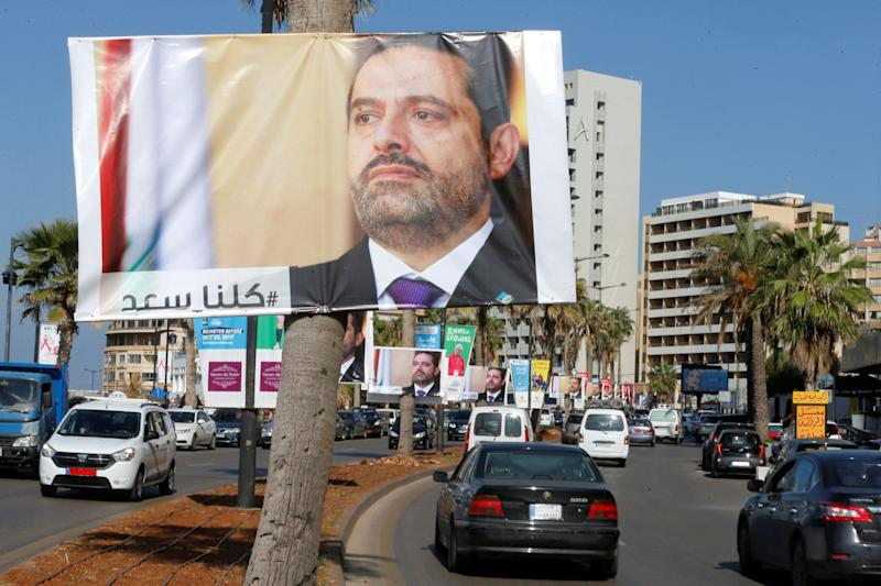 Posters of Lebanese Prime Minister Saad al-Hariri line the streets in Beirut. Many in Lebanon remain suspicious of his resignation announcement.