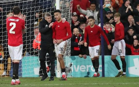 Manchester United manager Ole Gunnar Solskjaer speaks with Mason Greenwood - Credit: Reuters