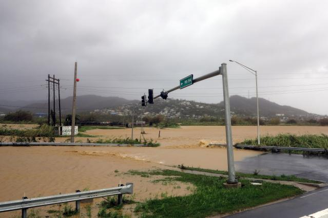<p>Flooded roads are seen as Hurricane Maria hits Puerto Rico in Fajardo, on Sept. 20, 2017. (Photo: Ricardo Arduengo/AFP/Getty Images) </p>