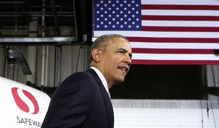 U.S. President Obama arrives to deliver remarks on the economy and fuel standards during a visit to a Safeway Distribution Center in Upper Marlboro