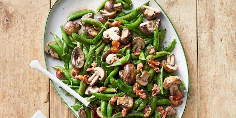 """<p>A crispy bacon topping takes this vegetable side to the next level.<br></p><p><strong><a href=""""https://www.countryliving.com/food-drinks/recipes/a37753/roasted-snap-peas-mushrooms-recipe/"""" rel=""""nofollow noopener"""" target=""""_blank"""" data-ylk=""""slk:Get the recipe"""" class=""""link rapid-noclick-resp"""">Get the recipe</a>.</strong> </p>"""