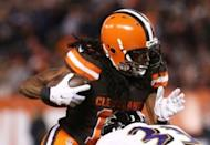 Cleveland Browns wide receiver Travis Benjamin (11) breaks a tackle from Baltimore Ravens strong safety Will Hill (33) in the first half at FirstEnergy Stadium. The Ravens won 33-27. Mandatory Credit: Aaron Doster-USA TODAY Sports