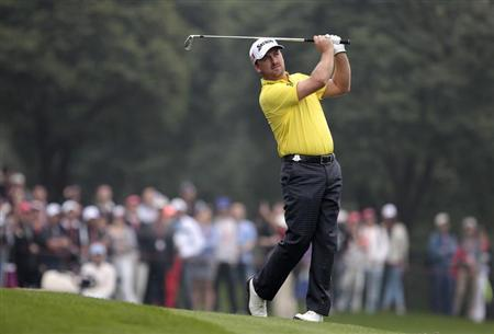 Graeme McDowell of Northern Ireland plays a shot on the 9th hole during the final round of the WGC-HSBC Champions golf tournament in Shanghai