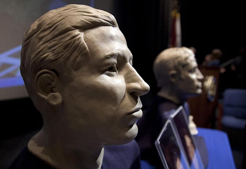 FILE - In this March 6, 2012 file photo, phases of facial reconstruction of the two sailors of the Civil War ironclad USS Monitor, older is at left, are on display in the auditorium of the United States Navy Memorial in Washington. The remains of the two unknown Union sailors recovered from the Civil War ironclad USS Monitor will be interred in Arlington National Cemetery on March 8, Navy Secretary Ray Mabus said Tuesday, Feb. 12, 2013. (AP Photo/Carolyn Kaster, File)