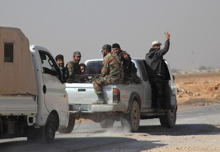 Syrian regime soldiers drive in a pick-up truck on the eastern outskirts of the northern Syrian city of Aleppo on October 21, 2015 (AFP Photo/George Ourfalian)