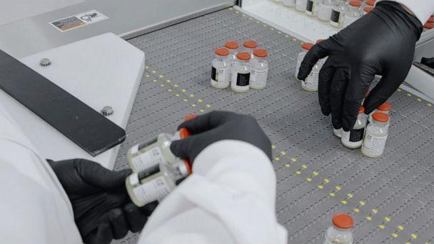 PHOTO: In this undated image from video provided by Regeneron Pharmaceuticals on Friday, Oct. 2, 2020, vials are inspected at the company's facilities in New York state, for efforts on an experimental coronavirus antibody drug. (Regeneron via AP)