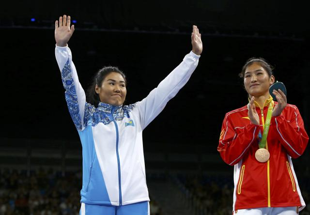 2016 Rio Olympics - Boxing - Victory Ceremony - Women's Middle (75kg) Victory Ceremony - Riocentro - Pavilion 6 - Rio de Janeiro, Brazil - 21/08/2016. Bronze medallist Dariga Shakimova (KAZ) of Kazakhstan reacts next to fellow bronze medallist Li Qian (CHN) of China. REUTERS/Peter Cziborra FOR EDITORIAL USE ONLY. NOT FOR SALE FOR MARKETING OR ADVERTISING CAMPAIGNS.