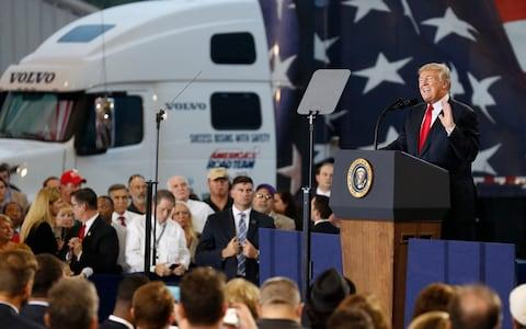 President Donald Trump speaks about tax reform during an event at the Harrisburg International Airport - Credit: AP