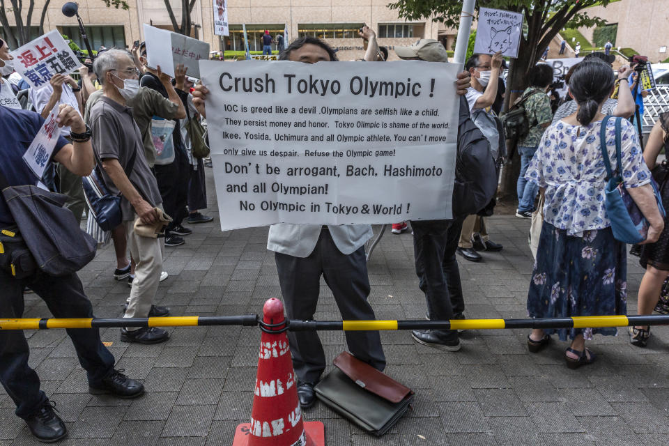 TOKYO, JAPAN - JULY 23: An anti-Olympics protester demonstrates during the Olympic Torch Relay Celebration event on July 23, 2021 in Tokyo, Japan. Protesters gathered to demonstrate against the Olympic Games amid concern over the safety of holding the event during the global coronavirus pandemic as well as the cost incurred. (Photo by Yuichi Yamazaki/Getty Images)