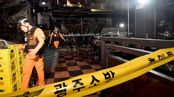 PHOTO: Rescue workers walk to inspect a collapsed internal balcony at a nightclub in Gwangju, South Korea, Saturday, July 27, 2019. (Shin Dae-hee/Newsis via AP)