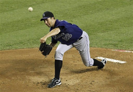 Colorado Rockies' Jeff Francis throws against the Arizona Diamondbacks during the first inning of a baseball game on Wednesday, Oct. 3, 2012, in Phoenix. (AP Photo/Ross D. Franklin)