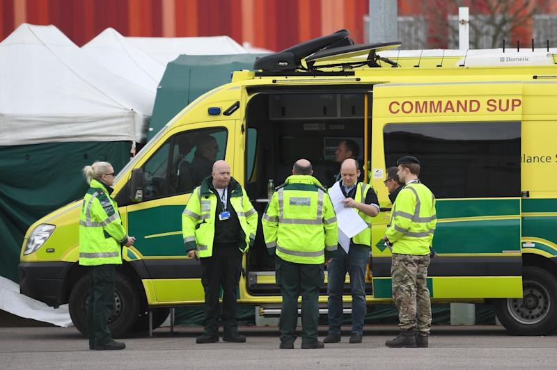 Ambulance crews and military personnel await the first patients at the ExCel centre in London which is being made into the temporary NHS Nightingale hospital to help tackle coronavirus. (Photo by Stefan Rousseau/PA Images via Getty Images)