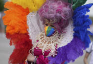 A football supporter wears a rainbow costume before the Euro 2020 soccer championship group F match between Germany and Hungary at the Allianz Arena in Munich, Germany,Wednesday, June 23, 2021. (AP Photo/Matthias Schrader)