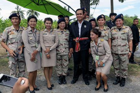 Thailand's Prime Minister Prayuth Chan-ocha poses for photo with local government officers at a farmer school in Suphan Buri province, Thailand September 18, 2017. REUTERS/Athit Perawongmetha