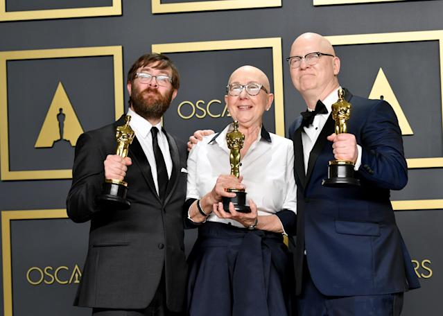 """Filmmakers Jeff Reichert, Julia Reichert, and Steven Bognar, winners of the Documentary Feature award for """"American Factory,"""" pose in the press room during the 92nd Annual Academy Awards at Hollywood and Highland on February 09, 2020 in Hollywood, California. (Photo by Amy Sussman/Getty Images)"""