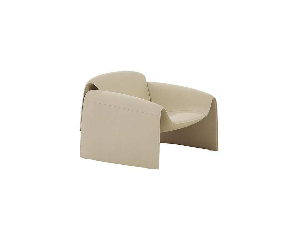 """<p>Seemingly created from a few undulating folds of fabric, Massaud's 'Le Club' armchair for Poliform may seem futuristic in form; in fact, its generous shape harks back to the traditional club chair of the past. Available in a palette of luxurious leathers and wools, it'll make for a sculptural presence in any space. £4,438, <a href=""""https://www.poliform.it/"""" rel=""""nofollow noopener"""" target=""""_blank"""" data-ylk=""""slk:poliform.it"""" class=""""link rapid-noclick-resp"""">poliform.it</a></p>"""