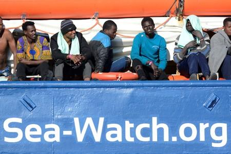 FILE PHOTO: Migrants rest on board the Sea Watch 3 off the coast of Siracusa