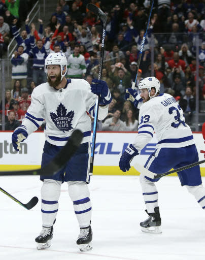 Toronto Maple Leafs defenseman Jake Muzzin, left, celebrates his third period goal with center Frederik Gauthier (33) during an NHL hockey game against the Detroit Red Wings, Saturday, Oct. 12, 2019, in Detroit. The Maple Leafs defeated the Red Wings 5-2. (AP Photo/Duane Burleson)