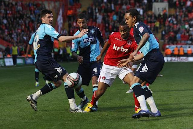 LONDON, ENGLAND - APRIL 21: Danny Haynes (2nd R) of Charlton is challenged by Wycombe Wanderers players for the ball during the npower League One match between Charlton Athletic and Wycombe Wanderers at The Valley on April 21, 2012 in London, England. (Photo by Oli Scarff/Getty Images)
