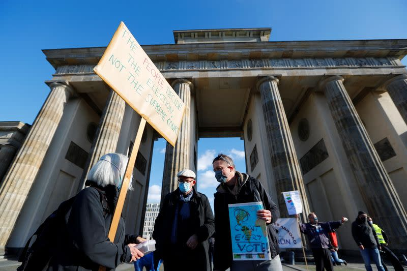 "Demonstrators attend the ""Count the Votes! Rally for Fair Elections in the USA"" organized by Young Democrats Abroad, in Berlin"