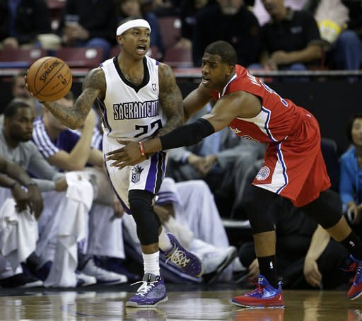 Sacramento Kings guard Isaiah Thomas, passes against Los Angeles Clippers guard Chris Paul during the first quarter of an NBA basketball game in Sacramento, Calif., Tuesday, March 19, 2013.(AP Photo/Rich Pedroncelli)