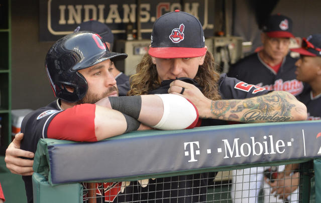 "<a class=""link rapid-noclick-resp"" href=""/mlb/teams/cle"" data-ylk=""slk:Cleveland Indians"">Cleveland Indians</a>' Jason Kipnis, left, is hugged by starting pitcher Mike Clevinger after the <a class=""link rapid-noclick-resp"" href=""/mlb/teams/hou"" data-ylk=""slk:Houston Astros"">Houston Astros</a> defeated the Indians 11-3 in Game 3 of a baseball American League Division Series, Monday, Oct. 8, 2018, in Cleveland. (AP Photo/Phil Long)"