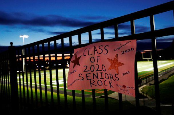 PHOTO: A sign honoring the Paul D. Schreiber Senior High School graduating class of 2020 is seen on a fence as the coronavirus disease (COVID-19) continues, while lights are turned on in tribute, at Whitney Field in Port Washington, New York, May 1, 2020. (Shannon Stapleton/Reuters)