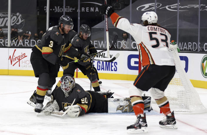 Anaheim Ducks left wing Max Comtois (53) reacts after scoring against the Vegas Golden Knights goalie Robin Lehner (90) during the first period of an NHL hockey game Thursday, Jan. 14, 2021, in Las Vegas. (AP Photo/Isaac Brekken)