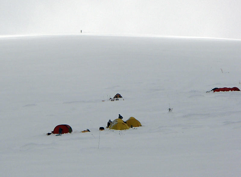 FILE- In this June 13, 2012, file photo provided by Disabled Sports USA, members of Warfighter Sports Denali Challenge set up tents attempting to climb Mount McKinley in Alaska. The five men, all severely wounded in war, including four who had amputations, had to abandon their climb of North America's tallest peak, but say it was weather and not their disabilities that ended the summit attempt. The five men descended Alaska's Mount McKinley on Monday, July 2. (AP Photo/Disabled Sports USA, File)
