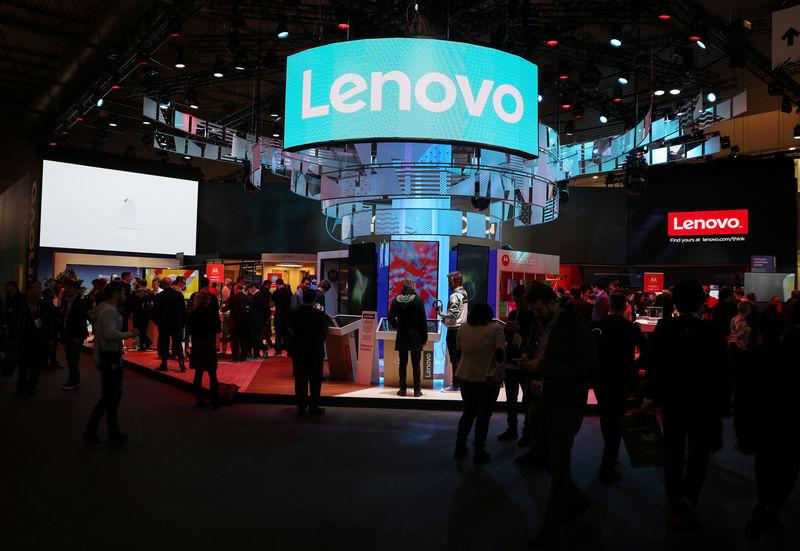 FILE PHOTO - Visitors attend the Lenovo booth at the Mobile World Congress in Barcelona, Spain, February 26, 2018. REUTERS/Sergio Perez/File Photo