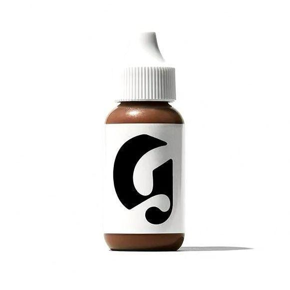 """<p><strong>Glossier</strong></p><p>glossier.com</p><p><strong>$26.00</strong></p><p><a href=""""https://go.redirectingat.com?id=74968X1596630&url=https%3A%2F%2Fwww.glossier.com%2Fproducts%2Fperfecting-skin-tint&sref=https%3A%2F%2Fwww.bestproducts.com%2Fbeauty%2Fg37048952%2Fdewy-foundations%2F"""" rel=""""nofollow noopener"""" target=""""_blank"""" data-ylk=""""slk:Shop Now"""" class=""""link rapid-noclick-resp"""">Shop Now</a></p><p><a href=""""https://www.forbes.com/sites/biancasalonga/2021/03/19/skinmalism-your-guide-to-the-biggest-beauty-trend-for-2021/"""" rel=""""nofollow noopener"""" target=""""_blank"""" data-ylk=""""slk:Skin minimalism"""" class=""""link rapid-noclick-resp"""">Skin minimalism</a> is one of the biggest 2021 beauty trends, so why not apply this curated approach to your makeup, too? </p><p>This ultra-lightweight, sheer coverage foundation is exactly what we're talking about: It's made to enhance the look of your natural skin instead of covering it up, creating a glowing, even canvas in the process.</p><p>Something to consider: This 12-shade skin tint is also the second pick on this list that's infused with diamond powder, yet it's a fraction of the price of its predecessor.</p>"""