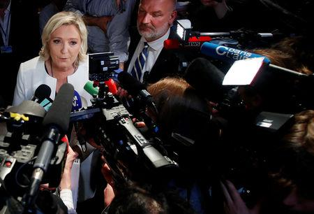 French far-right National Rally (Rassemblement National) party leader Marine Le Pen talks to the media after the first results in Paris, France, May 26, 2019. REUTERS/Charles Platiau