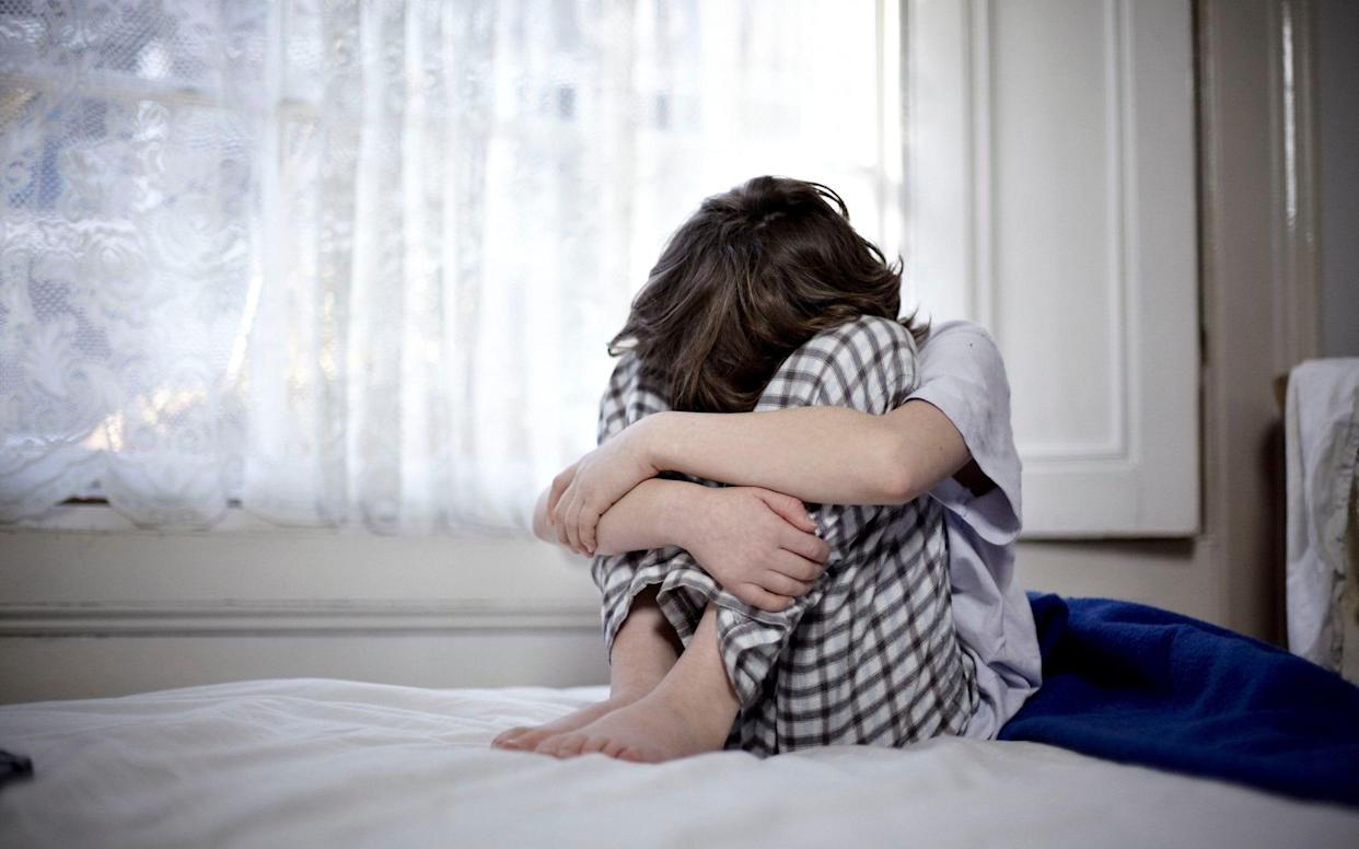 The youngest children in the academic school year are 30 per cent more likely to develop mental health problems, scientists have found. - PA