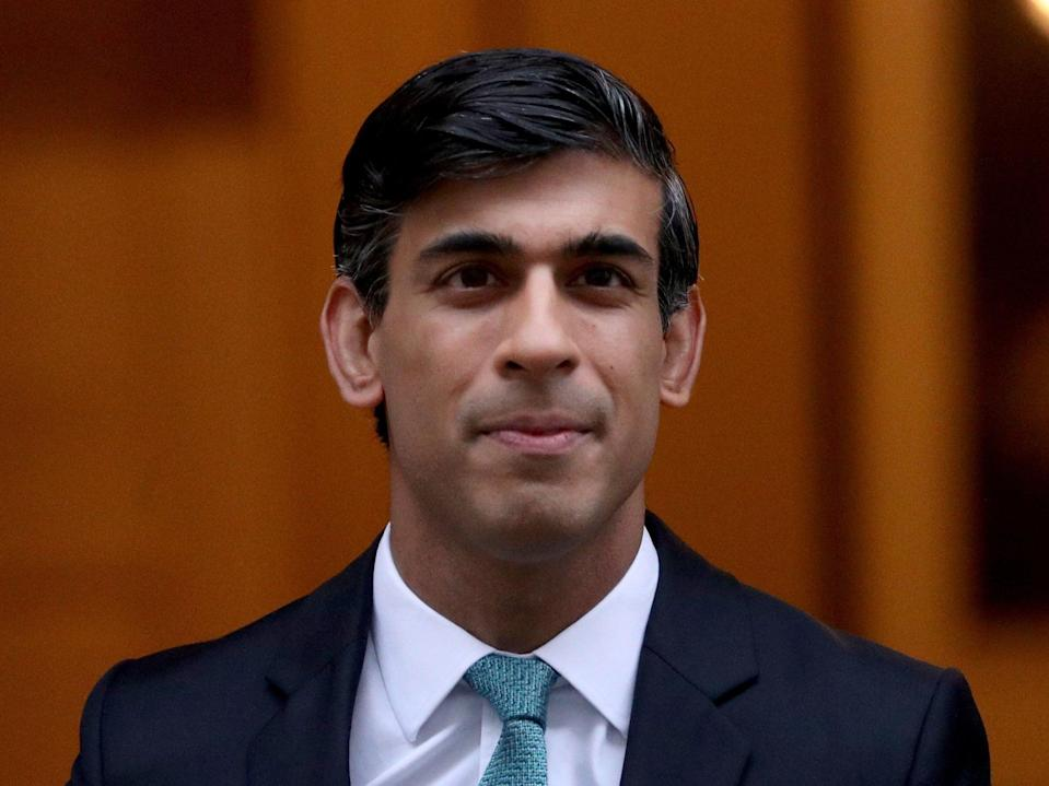 Rishi Sunak made a vast majority of house buyers exempt from paying the tax until the end of March (Yui Mok/PA)