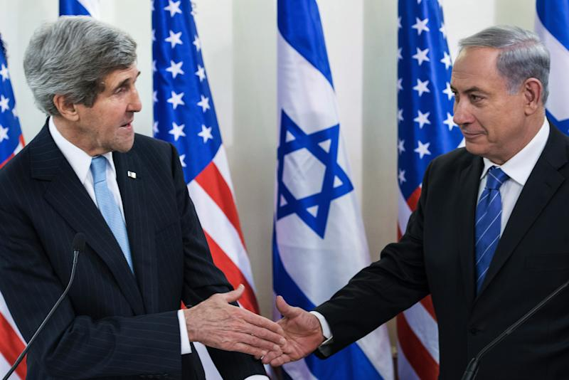 U.S. Secretary of State John Kerry, left, and Israeli Prime Minister Benjamin Netanyahu shake hands before a meeting at the prime minister's office in Jerusalem, Thursday, Jan. 2, 2014. Kerry arrived Thursday in Israel to broker Mideast peace talks that are entering a difficult phase aimed at reaching a two-state solution between the Israelis and Palestinians. (AP Photo/Brendan Smialowski, Pool)