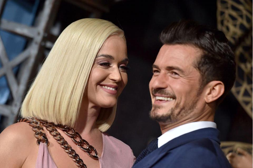 """<p>By May of 2016, these two were an official item. That summer, nude <a href=""""https://www.elle.com/uk/life-and-culture/culture/longform/a35154/orlando-bloom-interview/"""" rel=""""nofollow noopener"""" target=""""_blank"""" data-ylk=""""slk:photos"""" class=""""link rapid-noclick-resp"""">photos</a> of Bloom paddle-boarding went viral, as did the rest of their relationship. By the 2016 election, they had <a href=""""https://www.instagram.com/p/BMKy-fMA39o/?utm_source=ig_embed"""" rel=""""nofollow noopener"""" target=""""_blank"""" data-ylk=""""slk:nailed their Halloween-couple costumes"""" class=""""link rapid-noclick-resp"""">nailed their Halloween-couple costumes</a>. By March of 2017, they split, but in December of that year, they spent New Years together in Japan, and by February 2018, they were rumored <a href=""""https://www.elle.com/culture/celebrities/a26358205/katy-perry-orlando-bloom-relationship-timeline/"""" rel=""""nofollow noopener"""" target=""""_blank"""" data-ylk=""""slk:to be back together"""" class=""""link rapid-noclick-resp"""">to be back together</a>. Perry<a href=""""https://www.etonline.com/katy-perry-says-shes-spoken-for-amid-orlando-bloom-reconciliation-rumors-exclusive-100949"""" rel=""""nofollow noopener"""" target=""""_blank"""" data-ylk=""""slk:confirmed the news"""" class=""""link rapid-noclick-resp""""> confirmed the news </a>in April 2018. In <a href=""""https://www.instagram.com/katyperry/?utm_source=ig_embed"""" rel=""""nofollow noopener"""" target=""""_blank"""" data-ylk=""""slk:February 2019"""" class=""""link rapid-noclick-resp"""">February 2019</a>, they got engaged. </p>"""