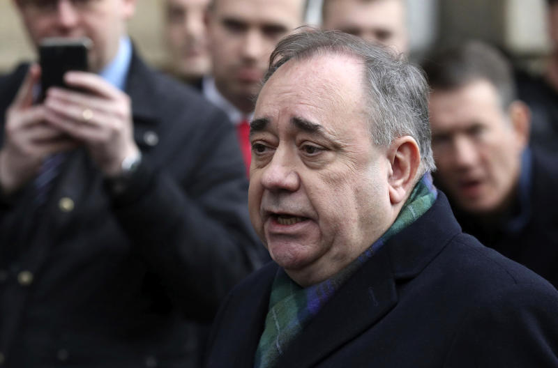 Former Scottish leader Alex Salmond speaks to the media after leaving the High Court in Edinburgh, Thursday Nov. 21, 2019. Salmond, one of the country's best-known politicians, appeared in court faces a total of 14 charges of attempted rape, sexual assault and indecent assault against 10 women. (Andrew Milligan/PA via AP)