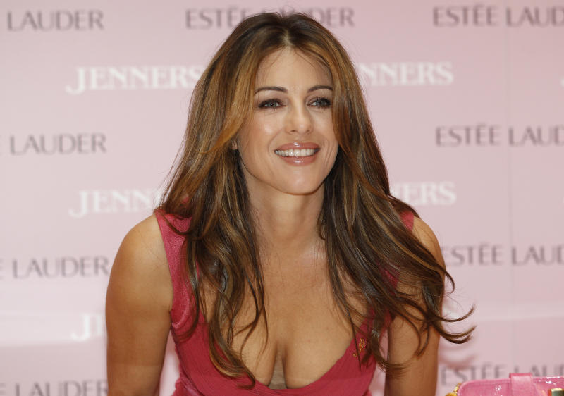 Actress and model Liz Hurley attends a breast cancer awareness launch at a department store in Edinburgh, Scotland October 4, 2011. REUTERS/David Moir (BRITAIN - Tags: ENTERTAINMENT HEALTH PROFILE)