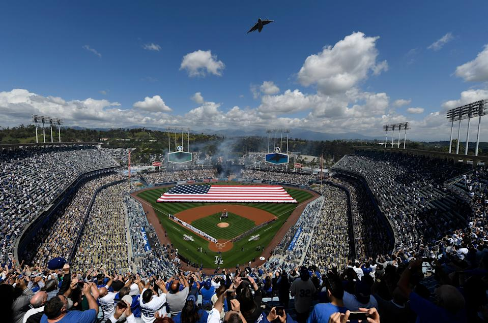 LOS ANGELES, CA - MARCH 28: Fans cheer as a Boeing C-17 Globemaster III military transport aircraft conducts a flyover from the 452nd Air Mobility Wing from March Air Reserve Base during the National Anthem onOpening Day between the Los Angeles Dodgers and Arizona Diamondbacks at Dodger Stadium on March 28, 2019 in Los Angeles, California. (Photo by Kevork Djansezian/Getty Images)