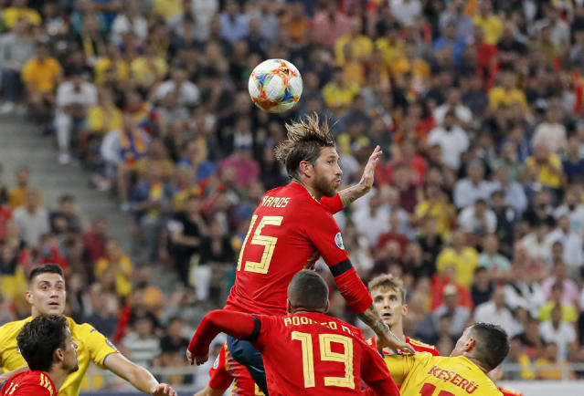Spain's Sergio Ramos jumps for a header during the Euro 2020 group F qualifying soccer match between Romania and Spain, at the National Arena stadium in Bucharest, Romania, Thursday, Sept. 5, 2019. (AP Photo/Vadim Ghirda)