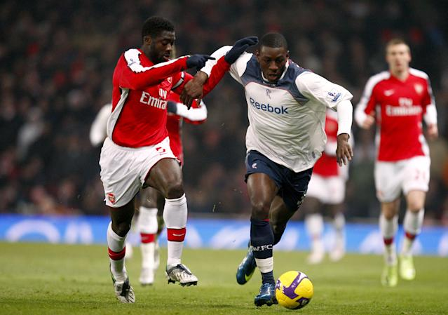 Bolton's Tope Obadeyi battling with Arsenal's Kolo Toure (Photo by Sean Dempsey - PA Images/PA Images via Getty Images)